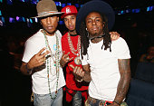 Recording artists Pharrell Williams Tyga and Lil Wayne attend the BET AWARDS '14 at Nokia Theatre LA LIVE on June 29 2014 in Los Angeles California