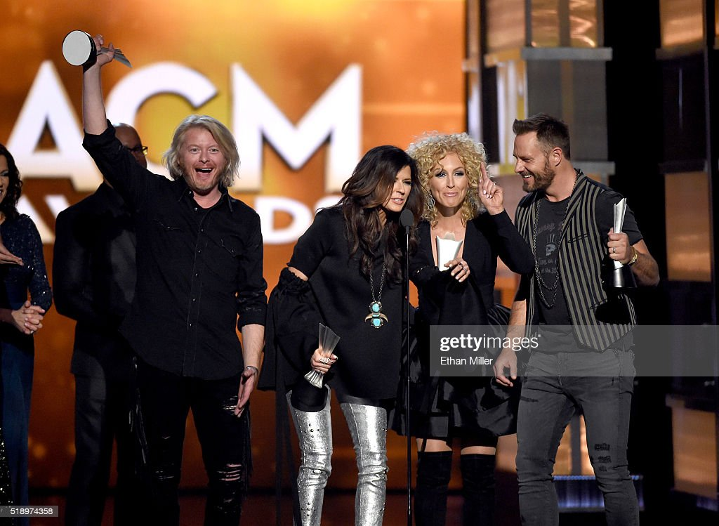 Recording artists Philip Sweet Karen Fairchild Kimberly Schlapman and Jimi Westbrook of music group Little Big Town accept the Vocal Group of the...
