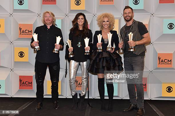 Recording artists Philip Sweet Karen Fairchild Kimberly Schlapman and Jimi Westbrook of Little Big Town winners of the Vocal Group of the Year award...