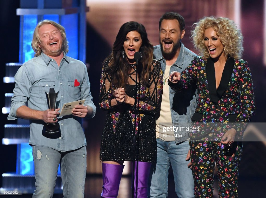 Recording artists Phillip Sweet, Karen Fairchild, Jimi Westbrook and Kimberly Schlapman of Little Big Town accept the Vocal Group of the Year award during the 52nd Academy of Country Music Awards at T-Mobile Arena on April 2, 2017 in Las Vegas, Nevada.