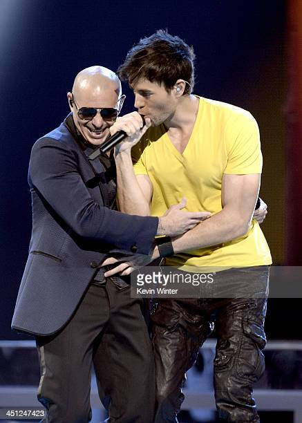 Recording artists Pitbull and Enrique Iglesias perform onstage during The 14th Annual Latin GRAMMY Awards at the Mandalay Bay Events Center on...