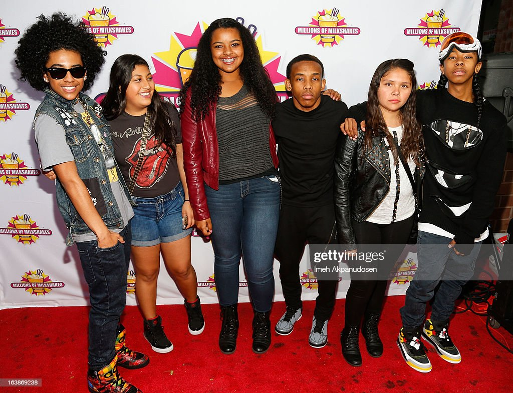 Recording artists Princeton (L), Prodigy (C), and Ray Ray (R) of the music group Mindless Behavior pose with fans during the launch of their milkshake at Millions Of Milkshakes on March 16, 2013 in West Hollywood, California.