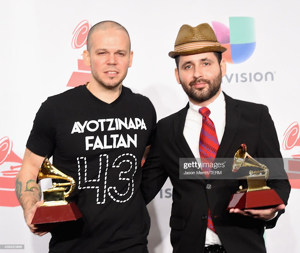 Recording artists Residente <a gi-track='captionPersonalityLinkClicked' href=/galleries/search?phrase=Calle+13&family=editorial&specificpeople=3707352 ng-click='$event.stopPropagation()'>Calle 13</a> (L) and Visitante of music group <a gi-track='captionPersonalityLinkClicked' href=/galleries/search?phrase=Calle+13&family=editorial&specificpeople=3707352 ng-click='$event.stopPropagation()'>Calle 13</a>, winners of Best Alternative Song, attend the 15th Annual Latin GRAMMY Awards at the MGM Grand Garden Arena on November 20, 2014 in Las Vegas, Nevada.