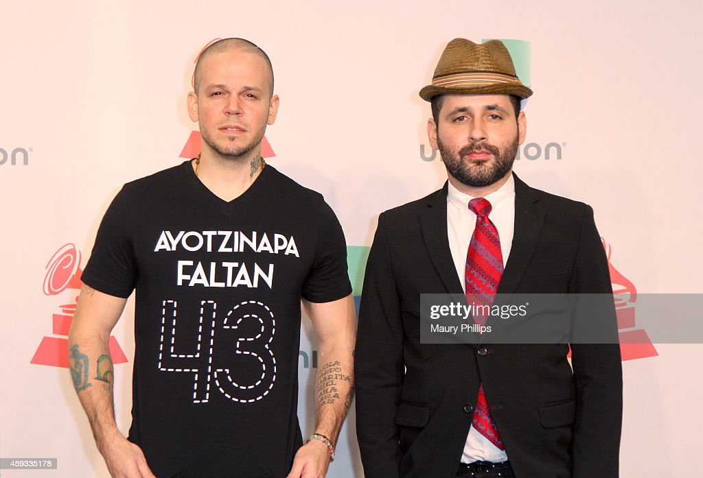 Recording artists Residente Calle 13 (L) and Visitante of music group Calle 13, winners of Best Alternative Song, pose in the press room during the 15th annual Latin GRAMMY Awards at the MGM Grand Garden Arena on November 20, 2014 in Las Vegas, Nevada.