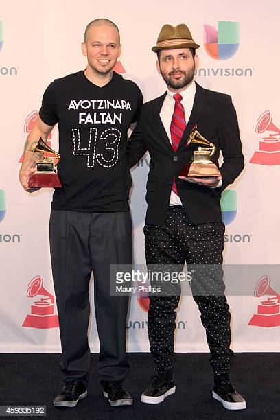 Recording artists Residente Calle 13 and Visitante of music group Calle 13 winners of Best Alternative Song pose in the press room during the 15th...