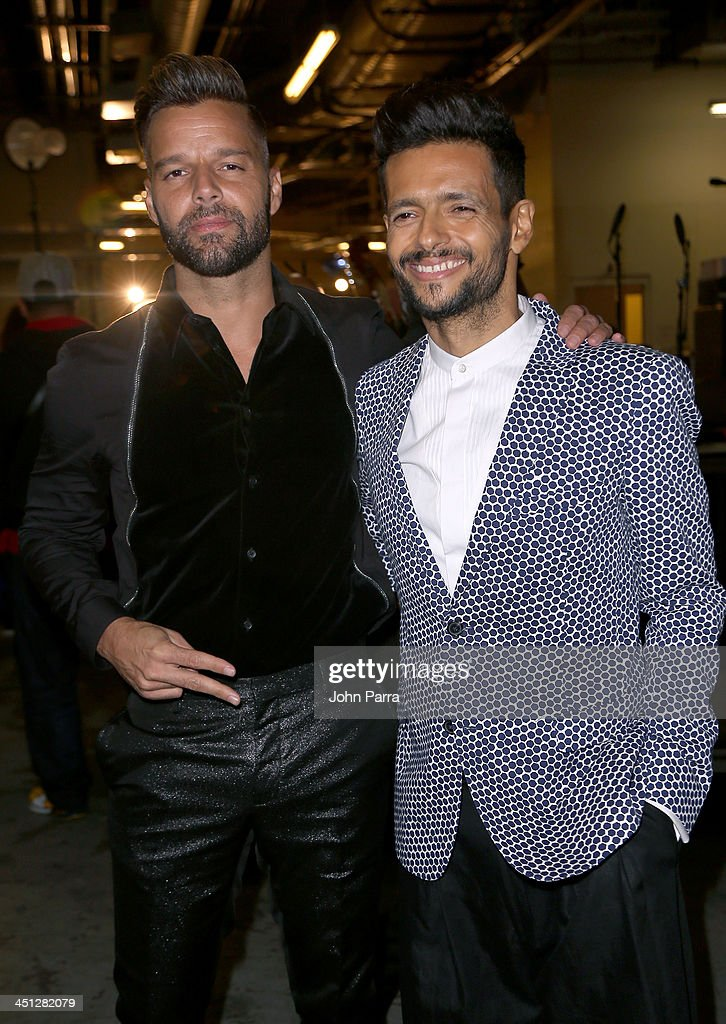 Recording artists <a gi-track='captionPersonalityLinkClicked' href=/galleries/search?phrase=Ricky+Martin&family=editorial&specificpeople=160450 ng-click='$event.stopPropagation()'>Ricky Martin</a> and Draco Rosa attend The 14th Annual Latin GRAMMY Awards at the Mandalay Bay Events Center on November 21, 2013 in Las Vegas, Nevada.