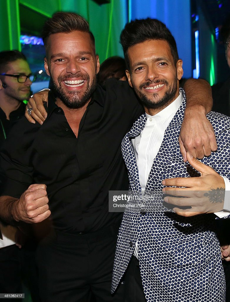 Recording artists <a gi-track='captionPersonalityLinkClicked' href=/galleries/search?phrase=Ricky+Martin&family=editorial&specificpeople=160450 ng-click='$event.stopPropagation()'>Ricky Martin</a> and Draco Rosa pose backstage during the 14th Annual Latin GRAMMY Awards held at the Mandalay Bay Events Center on November 21, 2013 in Las Vegas, Nevada.