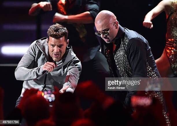 Recording artists Ricky Martin and Wisin perform onstage during the 16th Latin GRAMMY Awards at the MGM Grand Garden Arena on November 19 2015 in Las...