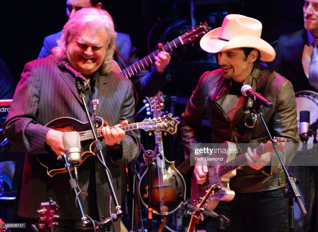 Recording Artists <a gi-track='captionPersonalityLinkClicked' href=/galleries/search?phrase=Ricky+Skaggs&family=editorial&specificpeople=2134089 ng-click='$event.stopPropagation()'>Ricky Skaggs</a> and <a gi-track='captionPersonalityLinkClicked' href=/galleries/search?phrase=Brad+Paisley&family=editorial&specificpeople=206616 ng-click='$event.stopPropagation()'>Brad Paisley</a> perform at the CMA Theater on November 18, 2013 in Nashville, Tennessee. Skaggs was recently announced as the Country Music Hall of Fame and Museum's 2013 Artist-in-Residence. (Photo by Rick Diamond/Getty Images