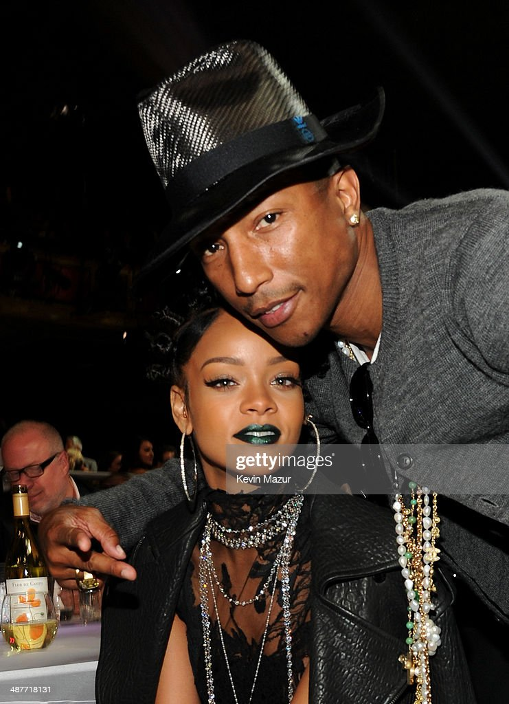 Recording artists Rihanna (L) and Pharrell Williams in the audience at the 2014 iHeartRadio Music Awards held at The Shrine Auditorium on May 1, 2014 in Los Angeles, California. iHeartRadio Music Awards are being broadcast live on NBC.