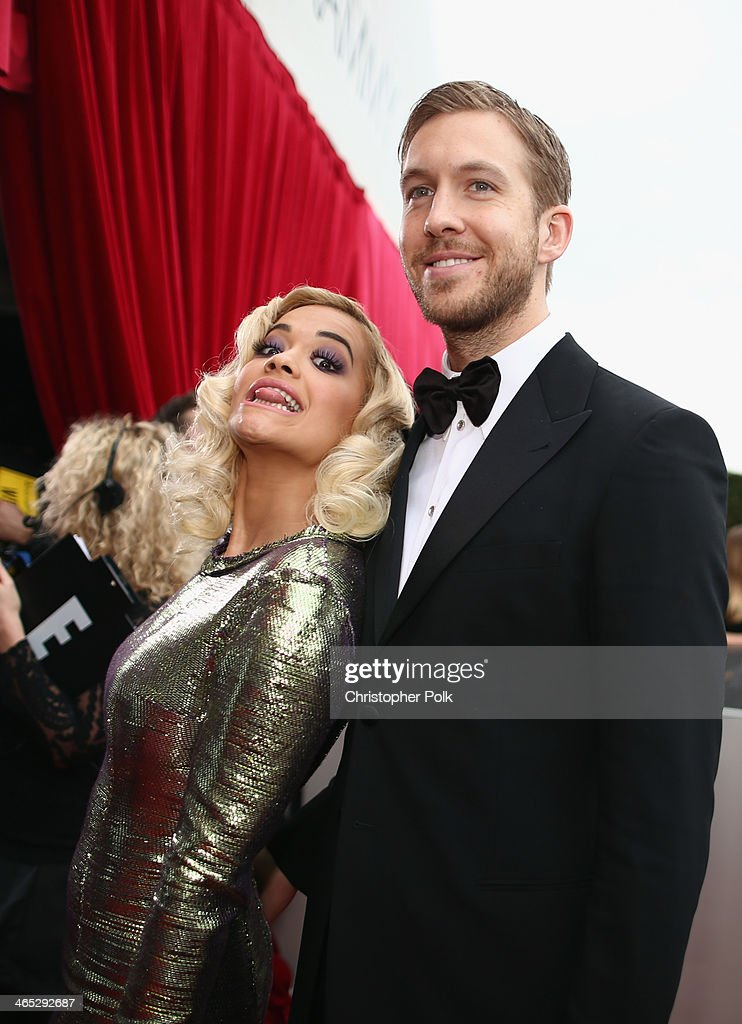 Recording artists Rita Ora and Calvin Harris attend the 56th GRAMMY Awards at Staples Center on January 26, 2014 in Los Angeles, California.
