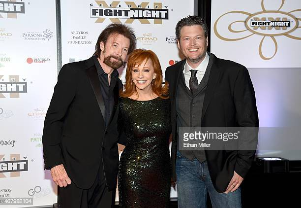 Recording artists Ronnie Dunn Reba McEntire and Blake Shelton attend Muhammad Ali's Celebrity Fight Night XXI at the JW Marriott Phoenix Desert Ridge...