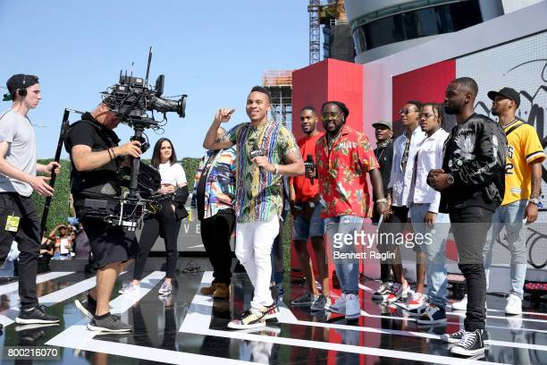 Recording artists Rotimi Ricky P Wiz Khalifa and members of Taylor Gang Entertainment speak onstage at day two of 2017 BETX Live sponsored by...