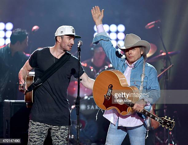 Recording artists Sam Hunt and Dwight Yoakam perform onstage during ACM Presents Superstar Duets at Globe Life Park in Arlington on April 17 2015 in...