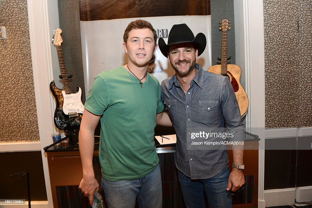 Recording artists <a gi-track='captionPersonalityLinkClicked' href=/galleries/search?phrase=Scotty+McCreery&family=editorial&specificpeople=7520936 ng-click='$event.stopPropagation()'>Scotty McCreery</a> (L) and <a gi-track='captionPersonalityLinkClicked' href=/galleries/search?phrase=Craig+Campbell+-+Singer&family=editorial&specificpeople=12522165 ng-click='$event.stopPropagation()'>Craig Campbell</a> attend the Dial Global Radio Remotes during The 48th Annual Academy of Country Music Awards at the MGM Grand on April 5, 2013 in Las Vegas, Nevada.
