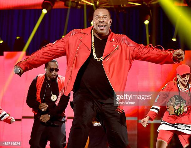 Recording artists Sean 'Puff Daddy' Combs and Busta Rhymes perform at the 2015 iHeartRadio Music Festival at the MGM Grand Garden Arena on September...