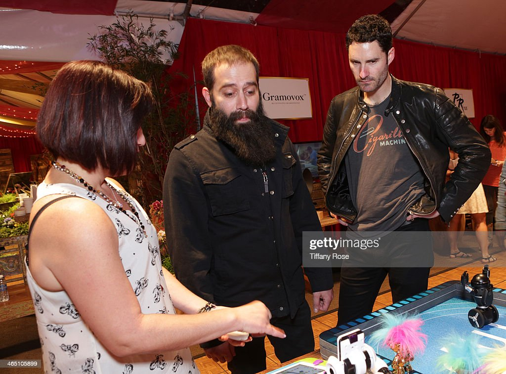 Recording artists Sebu Simonian and Ryan Merchant of Capital Cities attend the GRAMMY Gift Lounge during the 56th Grammy Awards at Staples Center on...