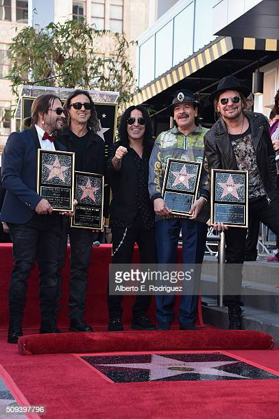 Recording artists Sergio Vallin Juan Calleros Alex Gonzalez Carlos Santana and Fher Olvera attend a ceremony honoring Maná with the 2573rd Star on...