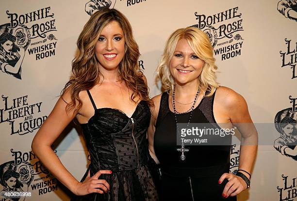 Recording artists Skye Claire and Kristen Kuiper of Whiskey Rose attend the product launch of Bonnie Rose a new Tennessee white whiskey on July 13...