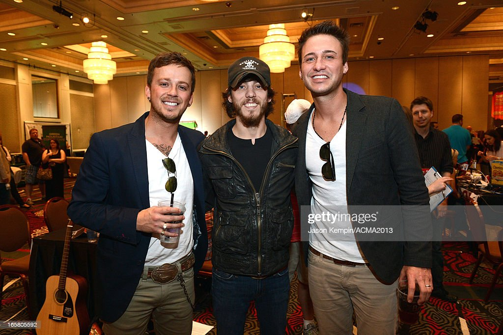 Recording artists Stephen Barker Liles (L) and Eric Gunderson (R) of music group Love and Theft and recording artist Chris Janson (C) attend the Dial Global Radio Remotes during The 48th Annual Academy of Country Music Awards at the MGM Grand on April 5, 2013 in Las Vegas, Nevada.