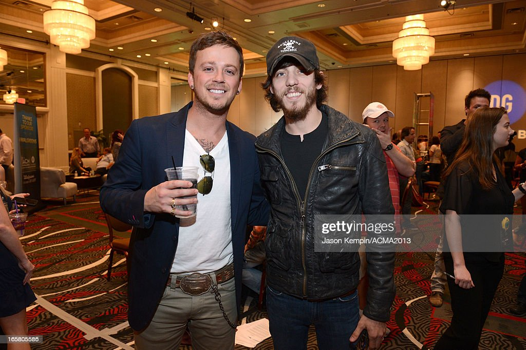 Recording artists Stephen Barker Liles (L) of music group Love and Theft and Chris Janson attend the Dial Global Radio Remotes during The 48th Annual Academy of Country Music Awards at the MGM Grand on April 5, 2013 in Las Vegas, Nevada.