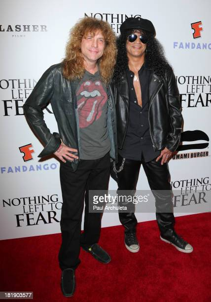 Recording Artists Steven Adler and Slash attend the 'Nothing Left To Fear' Los Angeles premiere at ArcLight Cinemas on September 25 2013 in Hollywood...