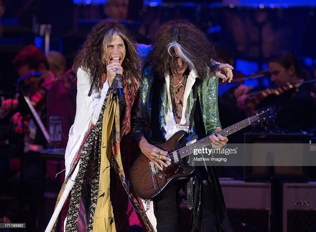 Recording artists Steven Tyler and Joe Perry perform at Hollywood Bowl Opening Night Gala - Inside at The Hollywood Bowl on June 22, 2013 in Los Angeles, California.