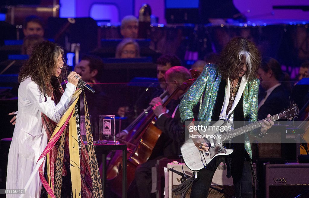 Recording artists <a gi-track='captionPersonalityLinkClicked' href=/galleries/search?phrase=Steven+Tyler&family=editorial&specificpeople=202080 ng-click='$event.stopPropagation()'>Steven Tyler</a> and <a gi-track='captionPersonalityLinkClicked' href=/galleries/search?phrase=Joe+Perry+-+Musicien&family=editorial&specificpeople=13600677 ng-click='$event.stopPropagation()'>Joe Perry</a> perform at Hollywood Bowl Opening Night Gala - Inside at The Hollywood Bowl on June 22, 2013 in Los Angeles, California.