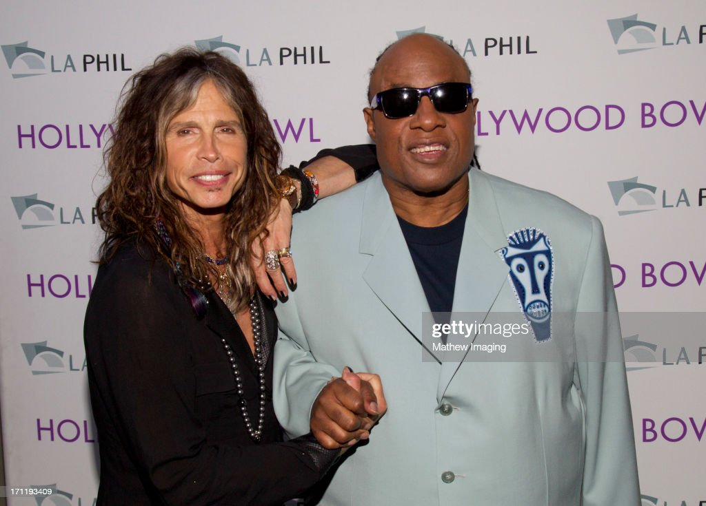 Recording artists <a gi-track='captionPersonalityLinkClicked' href=/galleries/search?phrase=Steven+Tyler+-+Musician&family=editorial&specificpeople=202080 ng-click='$event.stopPropagation()'>Steven Tyler</a> and <a gi-track='captionPersonalityLinkClicked' href=/galleries/search?phrase=Stevie+Wonder&family=editorial&specificpeople=171911 ng-click='$event.stopPropagation()'>Stevie Wonder</a> attend Hollywood Bowl Opening Night Gala - Inside at The Hollywood Bowl on June 22, 2013 in Los Angeles, California.