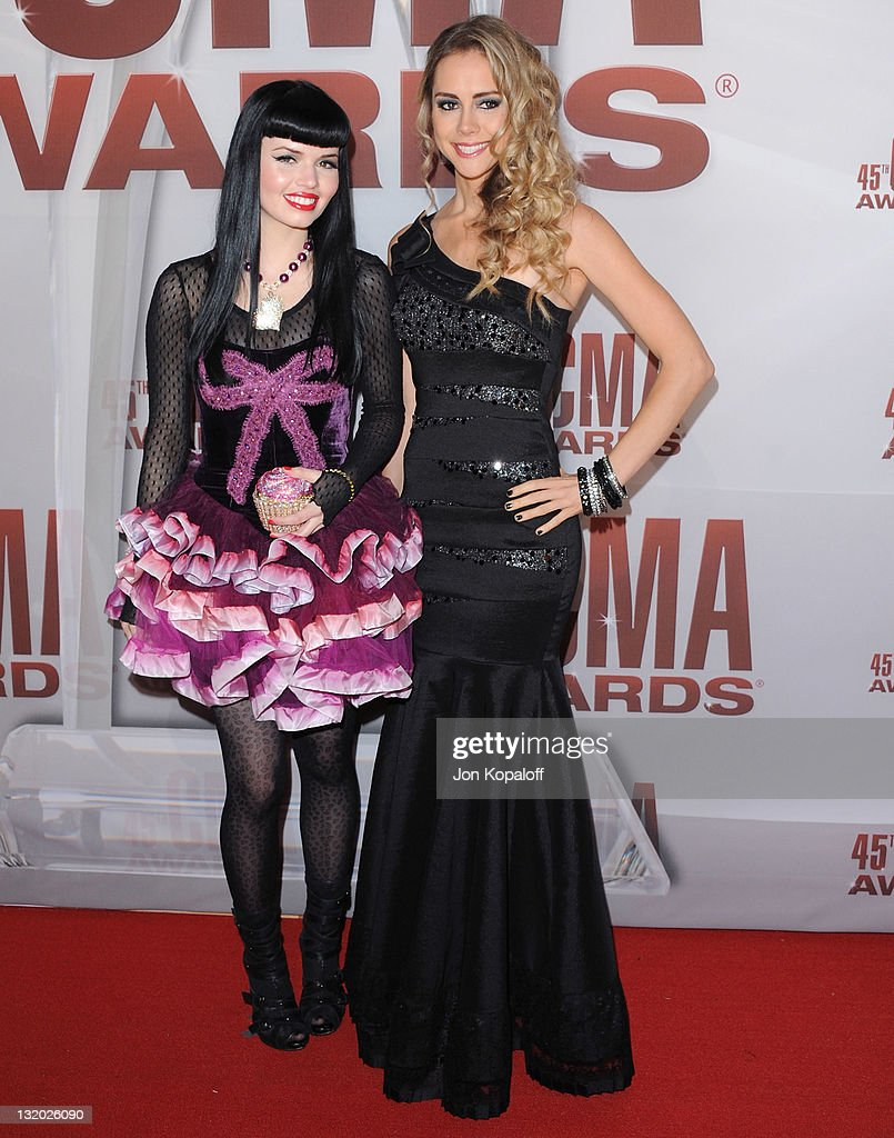 Recording artists Susie Brown and Danelle Leverett of The JaneDear Girls arrive at the 45th annual CMA Awards at the Bridgestone Arena on November 9, 2011 in Nashville, Tennessee.