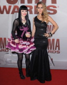 Recording artists Susie Brown and Danelle Leverett of The JaneDear Girls arrive at the 45th annual CMA Awards at the Bridgestone Arena on November 9...