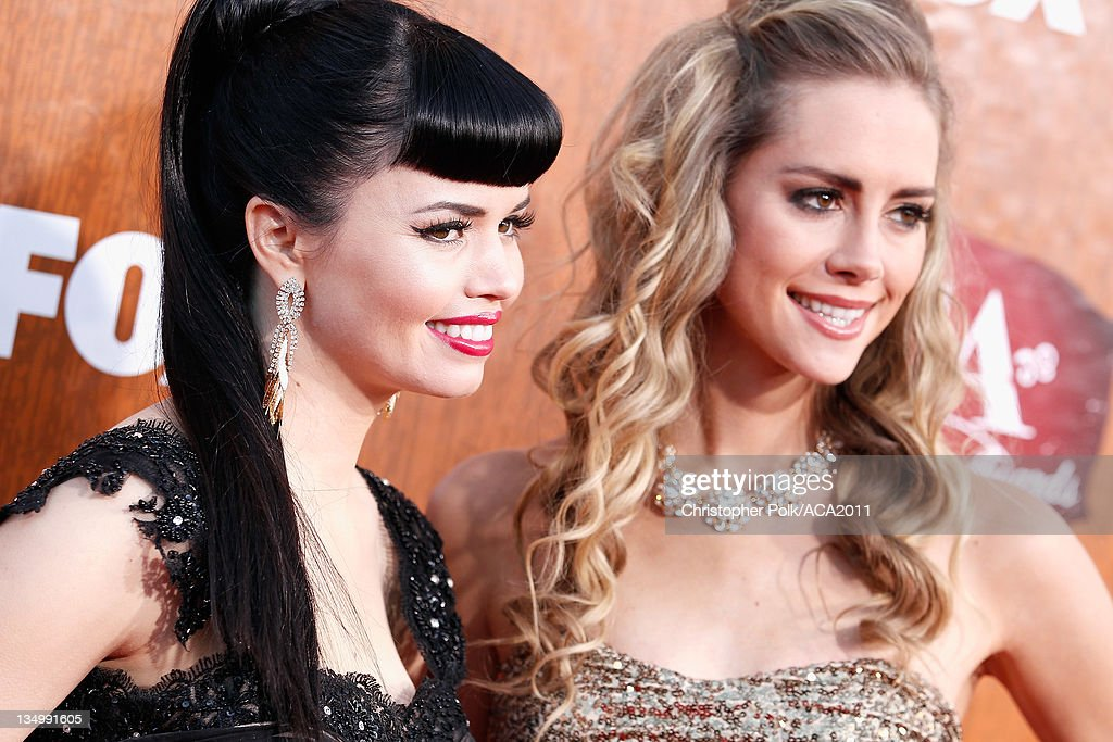 Recording artists Susie Brown (L) and Danelle Leverett of The JaneDear Girls arrive at the American Country Awards 2011 at the MGM Grand Garden Arena on December 5, 2011 in Las Vegas, Nevada.