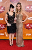 Recording artists Susie Brown and Danelle Leverett of The JaneDear Girls arrives at the American Country Awards 2011 at the MGM Grand Garden Arena on...