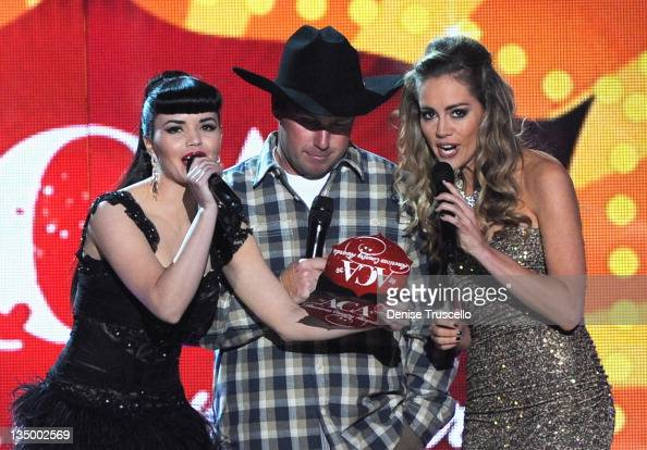 Recording artists Susie Brown and Danelle Leverett of The JaneDear Girls and comedian/singer Rodney Carrington speak onstage during the 2011 American...