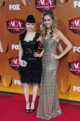 Recording artists Susie Brown and Danelle Leverett of The JaneDear Girls arrive for the American Country Awards at the MGM Grand Garden Arena on...