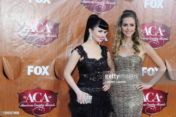 Recording artists Susie Brown and Danelle Leverett of The JaneDear Girls arrives for the American Country Awards at the MGM Grand Garden Arena on...