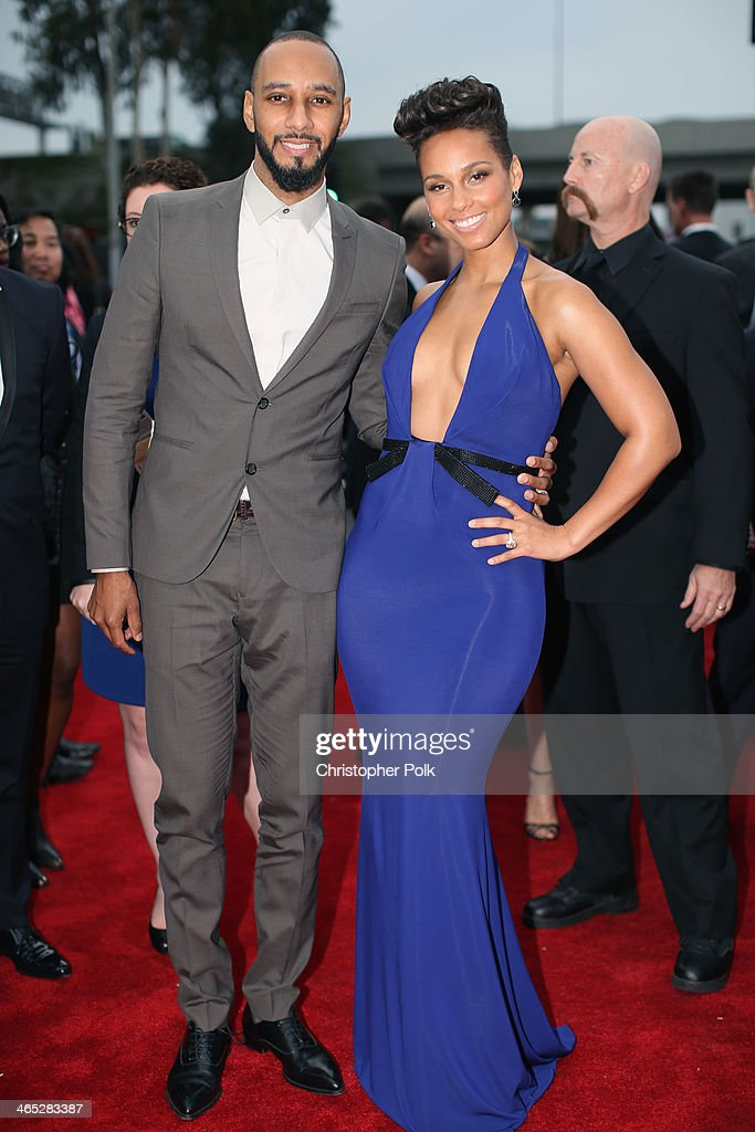 Recording artists Swizz Beatz (L) and Alicia Keys attend the 56th GRAMMY Awards at Staples Center on January 26, 2014 in Los Angeles, California.