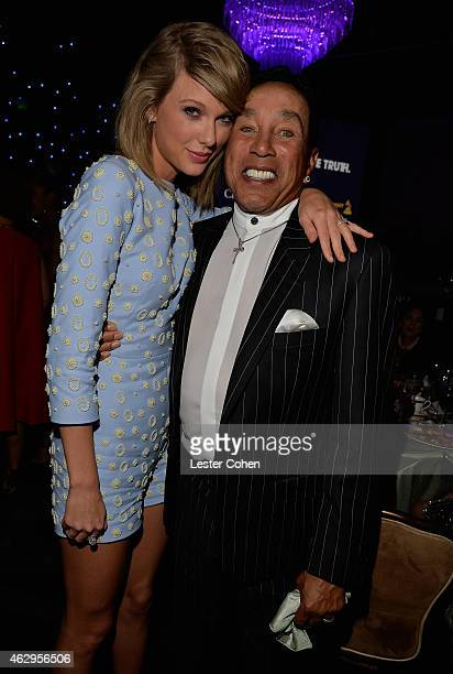 Recording artists Taylor Swift and Smokey Robinson attend the PreGRAMMY Gala and Salute to Industry Icons honoring Martin Bandier at The Beverly...