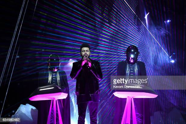 Recording artists The Weeknd and Daft Punk perform onstage during The 59th GRAMMY Awards at STAPLES Center on February 12 2017 in Los Angeles...