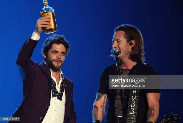 Recording artists Thomas Rhett and Tyler Hubbard perform onstage at the ACM Fan Jam After Party during the 49th Annual Academy of Country Music...