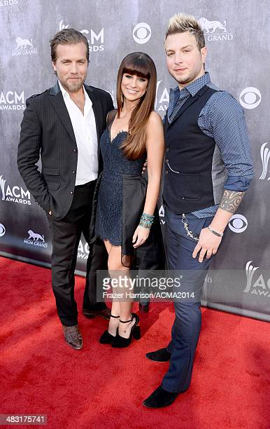 Recording artists Tom Gossin Rachel Reinert and Mike Gossin of Gloriana attend the 49th Annual Academy of Country Music Awards at the MGM Grand...