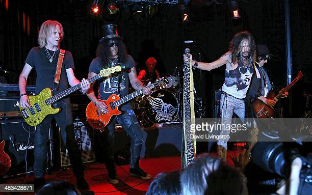 Recording artists Tom Hamilton Slash Joey Kramer Steven Tyler and Joe Perry perform on stage where Aerosmith announced a tour with Slash featuring...