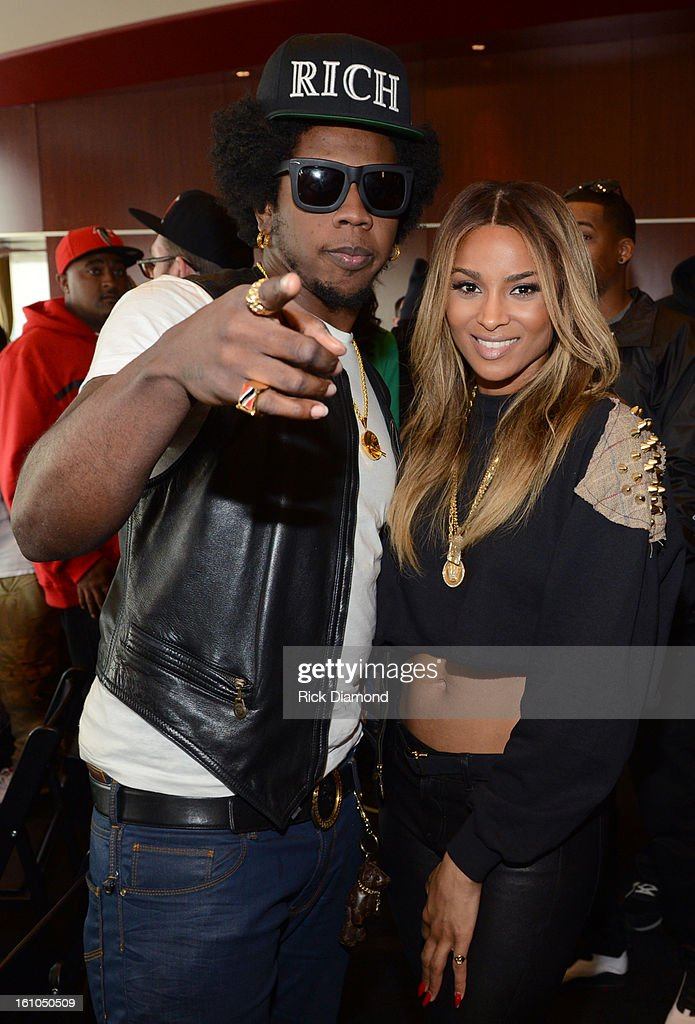 Recording artists Trinidad James (L) and Ciara pose backstage at the GRAMMYs Dial Global Radio Remotes during The 55th Annual GRAMMY Awards at the STAPLES Center on February 8, 2013 in Los Angeles, California.