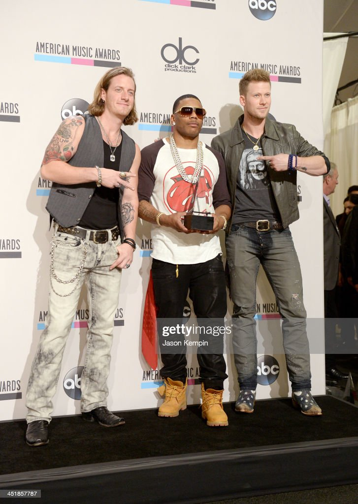 Recording artists <a gi-track='captionPersonalityLinkClicked' href=/galleries/search?phrase=Tyler+Hubbard&family=editorial&specificpeople=9453787 ng-click='$event.stopPropagation()'>Tyler Hubbard</a> (L) and Brian Kelley of Florida Georgia Line and Nelly (center) pose in the press room during the 2013 American Music Awards at Nokia Theatre L.A. Live on November 24, 2013 in Los Angeles, California.