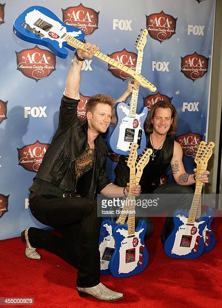 Recording artists Tyler Hubbard and Brian Kelley of Florida Georgia Line pose with the awards for Artist of the Year New Artist Single of the Year...
