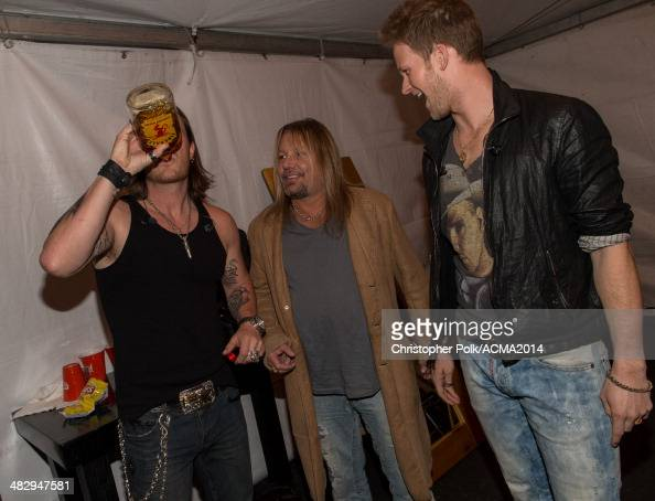 Recording artists Tyler Hubbard Brian Kelley of the music group Florida Georgia Line and Vince Neil backstage during day one of the ACM Party for A...