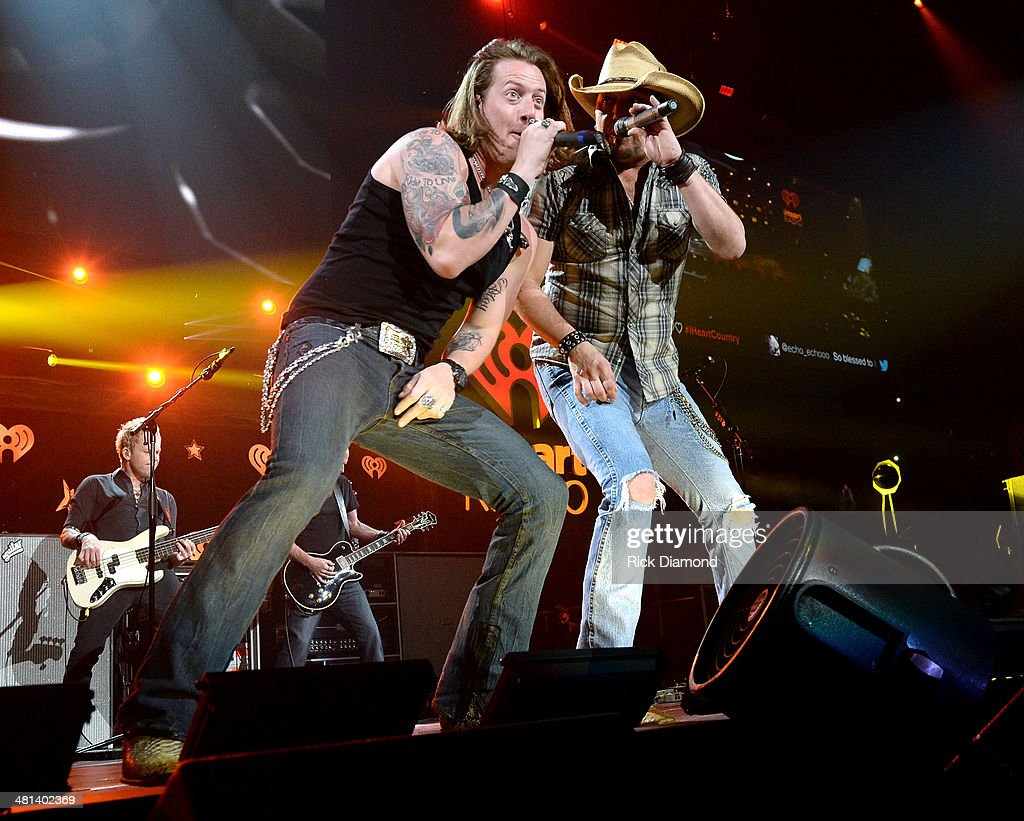 Recording artists Tyler Hubbard of Florida Georgia Line (L) and Jason Aldean perform onstage during iHeartRadio Country Festival in Austin at the Frank Erwin Center on March 29, 2014 in Austin, Texas.