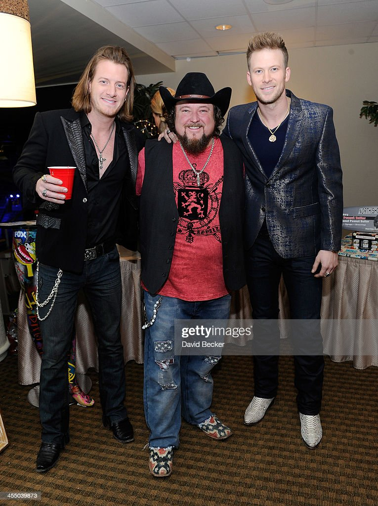 Recording artists <a gi-track='captionPersonalityLinkClicked' href=/galleries/search?phrase=Tyler+Hubbard&family=editorial&specificpeople=9453787 ng-click='$event.stopPropagation()'>Tyler Hubbard</a> of Florida Georgia Line, <a gi-track='captionPersonalityLinkClicked' href=/galleries/search?phrase=Colt+Ford&family=editorial&specificpeople=5348774 ng-click='$event.stopPropagation()'>Colt Ford</a> and Brian Kelley of Florida Georgia Line attends the Backstage Creations Celebrity Retreat at the American Country Awards 2013 at the Mandalay Bay Events Center on December 10, 2013 in Las Vegas, Nevada.
