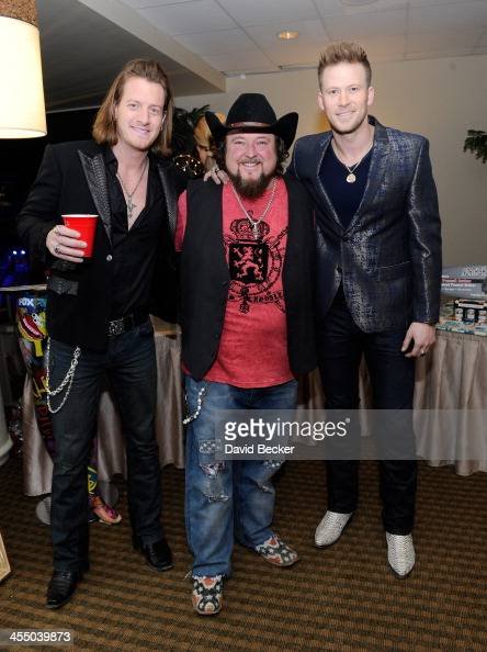 Recording artists Tyler Hubbard of Florida Georgia Line Colt Ford and Brian Kelley of Florida Georgia Line attends the Backstage Creations Celebrity...