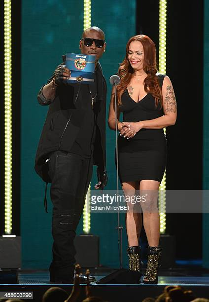 Recording artists Tyrese and Faith Evans present an award onstage during the 2014 Soul Train Music Awards at the Orleans Arena on November 7 2014 in...